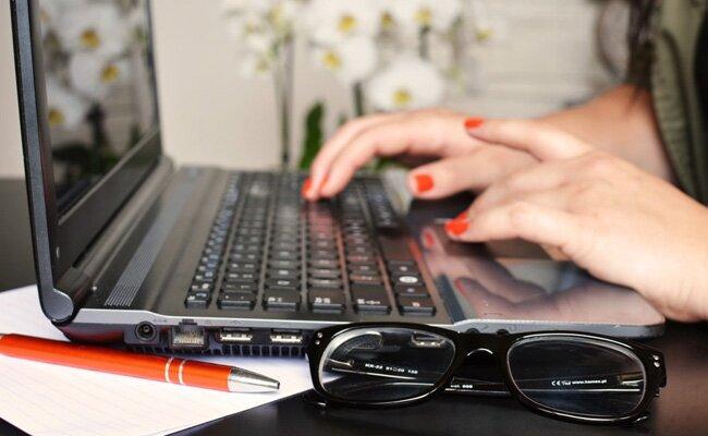 person-woman-desk-laptop-large copy